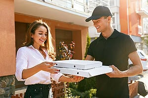 Pizza-Delivery-to-Smiling-Female